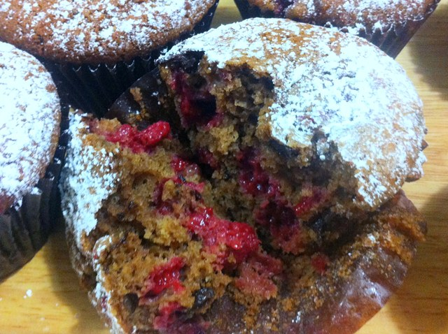 Double Chocolate Hermann Happiness. Muffins with Raspberries, Almonds, Dutch Cocoa and Choc Chunks.