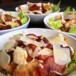 https://thepaddingtonfoodie.com/2013/02/22/reinterpreting-an-old-favourite-caesar-salad-with-poached-chicken-and-maple-roasted-bacon/