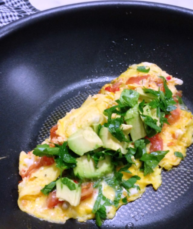 Tomato and Chilli Omelette With Avocado and Soft Herbs