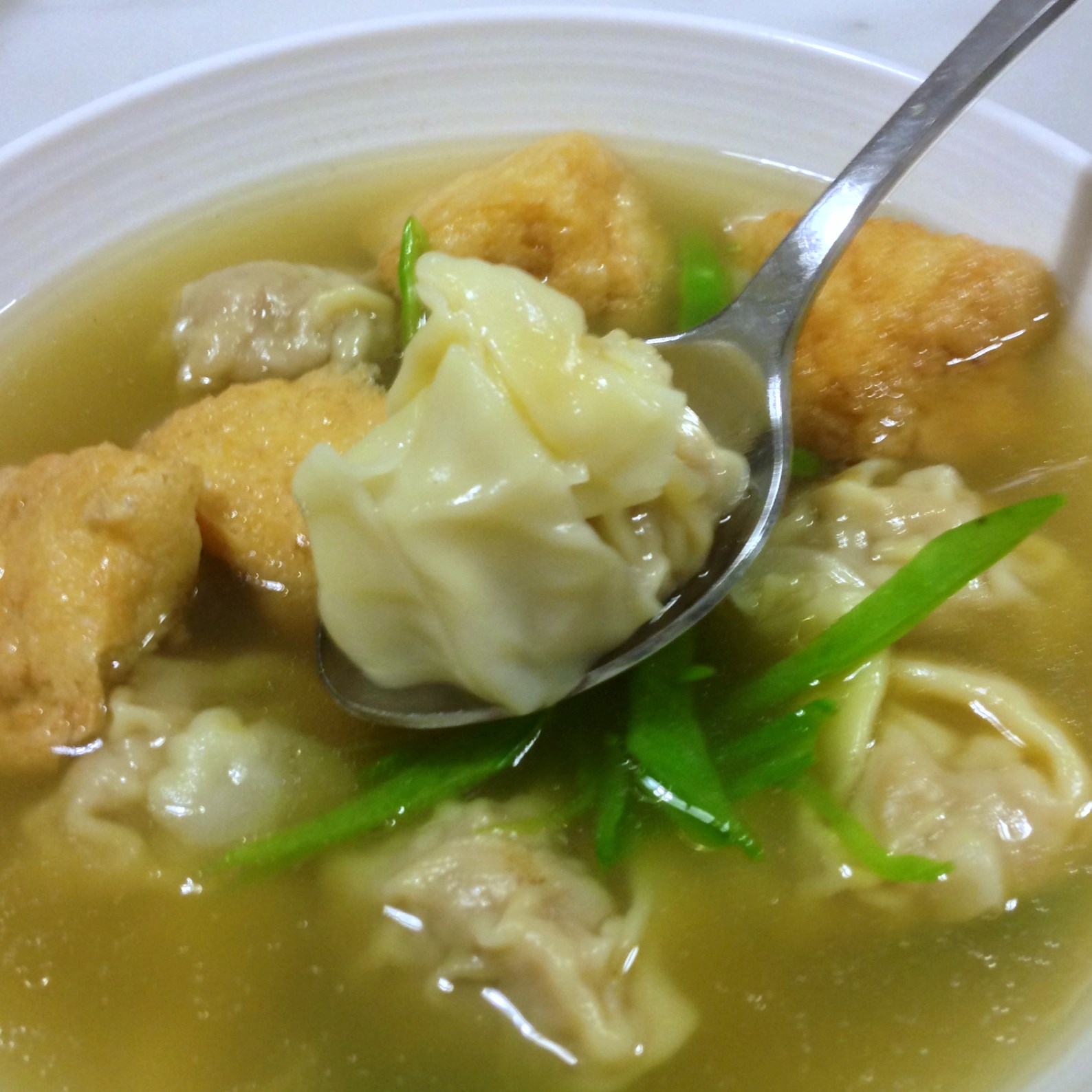 Comfort Eating At Its Best Pork Wonton Soup With Deep Fried Tofu Puffs And Shredded Snow Peas
