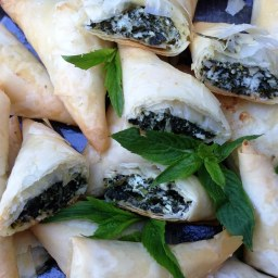 https://thepaddingtonfoodie.com/2014/01/09/the-summer-edition-folding-with-filo-spinach-herb-and-cheese-triangles/