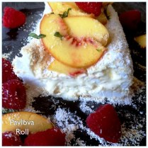 Pavlova Roll With Lemon Curd, Peaches, Raspberries And Coconut
