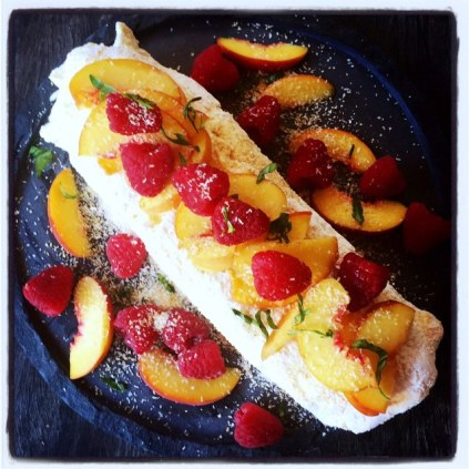 Pavlova Roulade With Lemon Curd, Peaches, Raspberries And Coconut